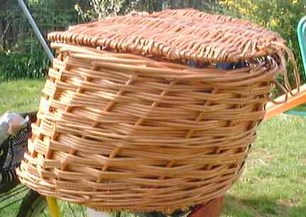 Aerodynamic basket for recumbent bicycle