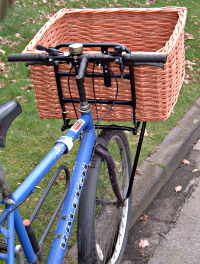 Basket fitted to delivery bicycle